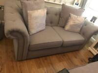 Two sofas and footstool
