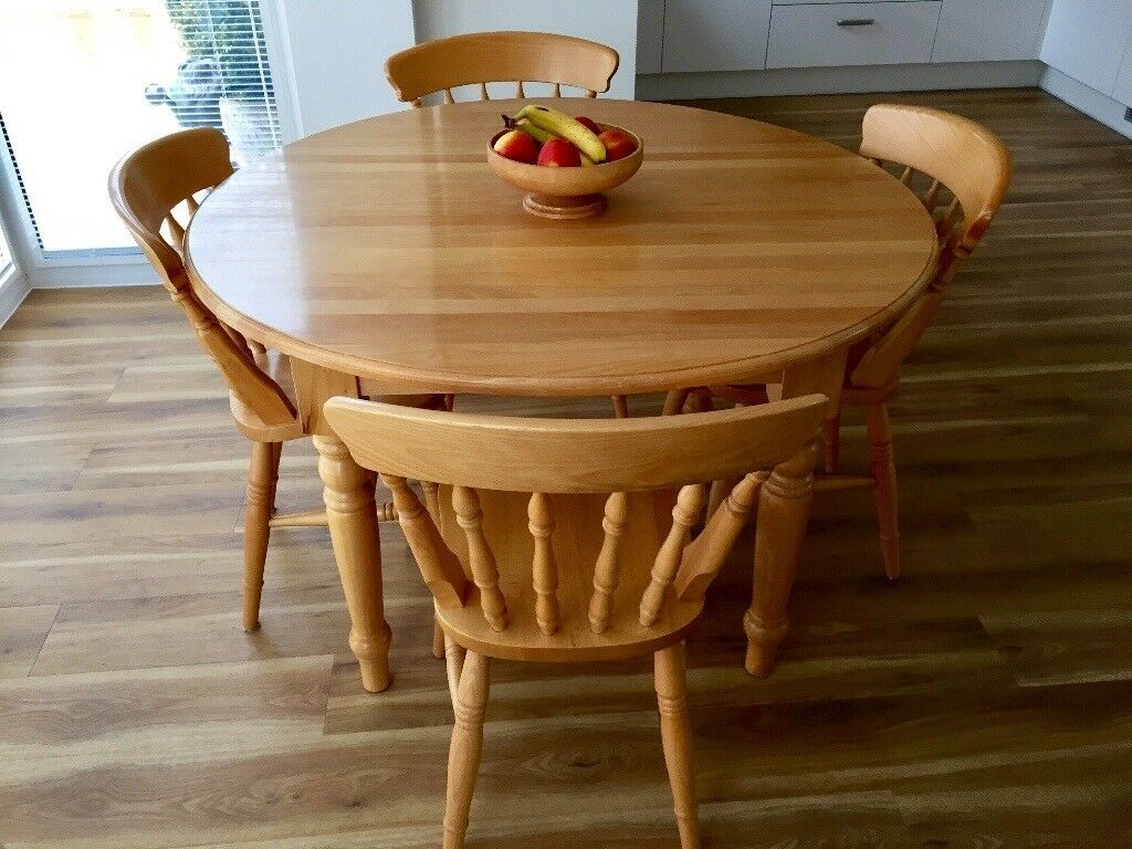 SoIid Round Wooden TableWipeable Surface With Matching Chairs - Round wooden table with 4 chairs