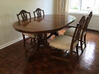 Extendable mahogany dining table with chairs - sits 8