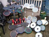 Selection of 8 gaming drums and 2 guitars.