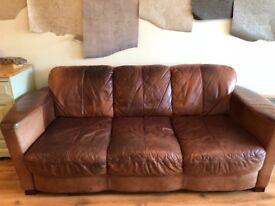 Brown leather four piece suite