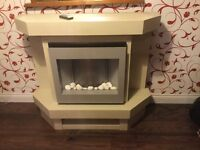 Free standing fully lit fireplace with built in electric fire and remote control in good condition