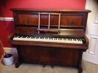 Upright Walnut piano by Godfrey yeovil