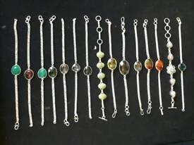Silver bracelets with precious stones