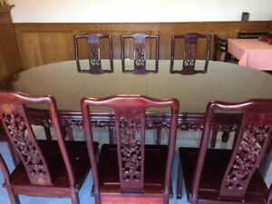 Nice Chinese Rosewood table with chairs.