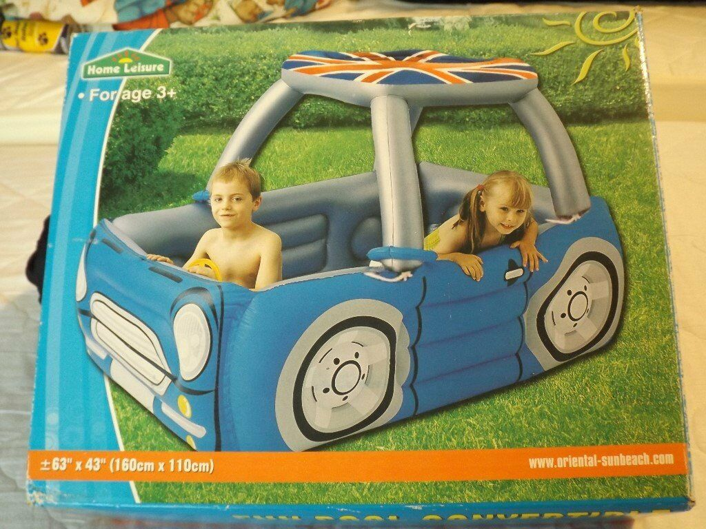 Inflatable fun pool in the shape of a convertible car
