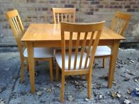 Light wooden table & 4 cream chairs (2 chairs have couple stains should wash off)