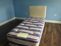 Single bed with mattress and cream faux leather headboard, rarely used, in excellent condition