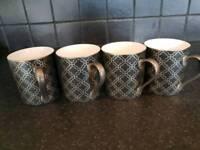 Four unused Mugs