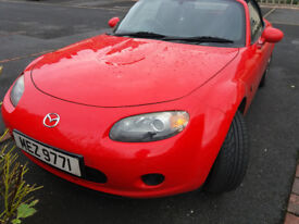 Red sporty Mx-5, new engine with only 44000 miles guaranteed for 6 months.