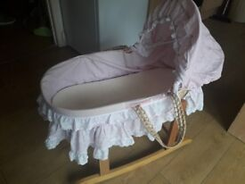 Can deliverLovely little pink moses basket with rocker stand and 2 mattresess