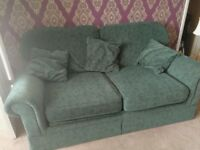 2-seater green sofa bed