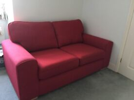 2/3 seater almost new red sofa