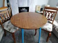 Beautiful drop leaf table and 2 solid wood chairs