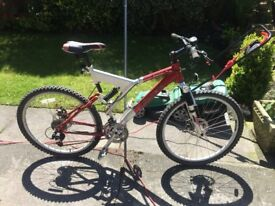 GENTS CARRERA MOUNTAIN BIKE 18 GEARS FRONT AND BACK SUSPENSION DISC BRAKES RIDES VERY WELL
