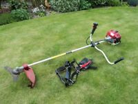 Sanli engine powered brushcutter GTS43. As new, only used twice. With harness and instuction booklet