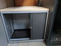 Low silver tambour with maple top, sliding doors. Storage cupboard