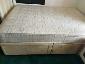 Double bed with mattress and two drawers.