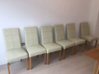 6 dining chairs in cream leather and oak legs