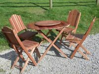 Wooden garden patio table with four chairs