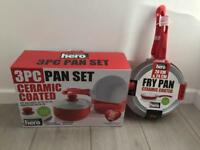 Red 'Your Kitchen Hero' saucepan and frying pan set