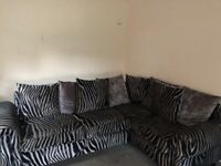 Black and silver zebra print corner sofa and single arm chair