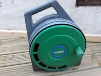 Hozelock hose reel with water hose pipe