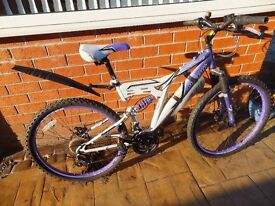 Girls Bicycle Purple 18 Gears with Sprung suspension and disc brakes Good condition