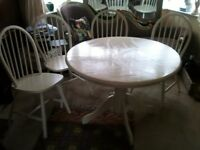 Round white table and 4 chairs.