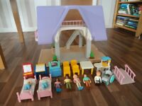 Vintage Little Tikes Dolls House with furniture and seven dolls including rare boy in wheelchair