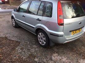Nice clean car good condition 5 door radio,roof rack,green metallic