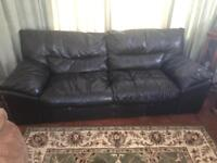BLACK LEATHER SOFA. CAN DELIVER.