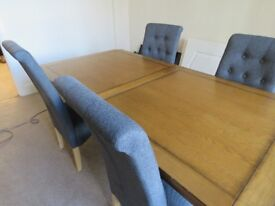 4 chairs andsolid extending dinning table - 4 months old , exellant condition