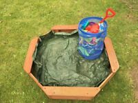 Wooden sandpit and toys
