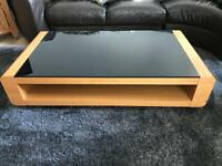 Sold wood coffee table