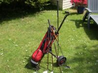 Junior set of right handed golf clubs with trolley and bag