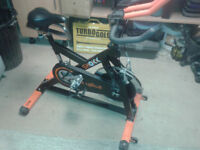 SHOKK REVOLVE SPIN BIKE IN GREAT FULL WORKING CONDITION, PROFFESSIONAL EQUIPMENT