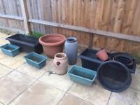 Collection of assorted planter pots and soil sieve