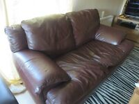 2 seater brown leather sofa.