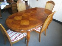 EXTENDING PATTERNED VENEER DINING TABLE WITH FOUR MATCHING CANE BACK DINING CHAIRS FREE DELIVERY