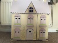 Lovely ELC Rosebud wooden dolls house with lots of furniture and a few people.