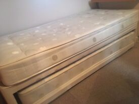 Single divan bed with both mattresses.