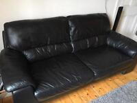 Three seater black leather couch