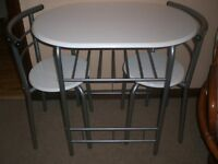 SMALL CREAM GLOSS DINING TABLE AND TWO MATCHING CHAIRS WITH UNDER-LEDGE