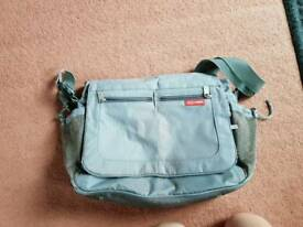 Skip Hop messenger style baby changing bag. Used but good condition. Few marks
