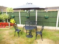 PATIO GARDEN FURNITURE. TABLE 2 CHAIRS,BENCH, PARASOL AND BASE.
