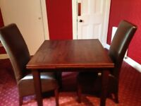 Dining table and Two leather chairs
