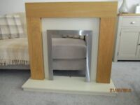 oak surround with a cream back panel and hearth
