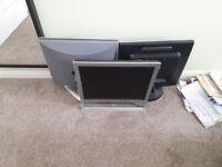 3 computer monitors