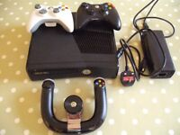 XBOX 360 + 2 WIRELESS CONTROLS+ STEERING WHEEL+ 7 GAMES